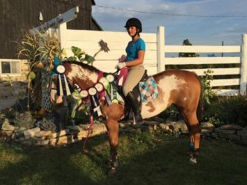 Woman on horse with prizes during Preston Rosedale Show